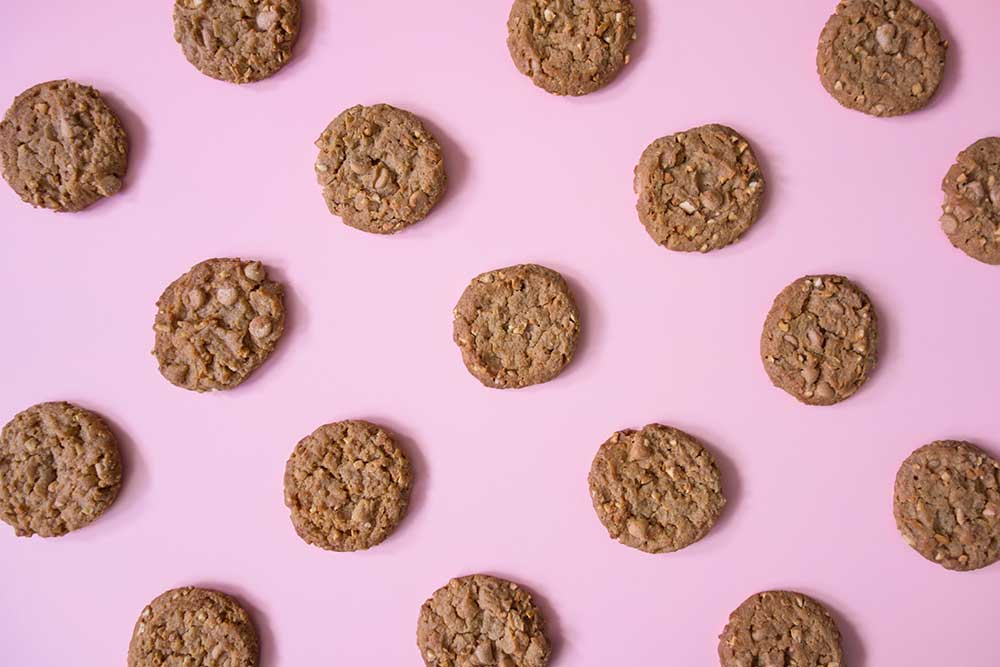 Tray of cookies on pink background header image